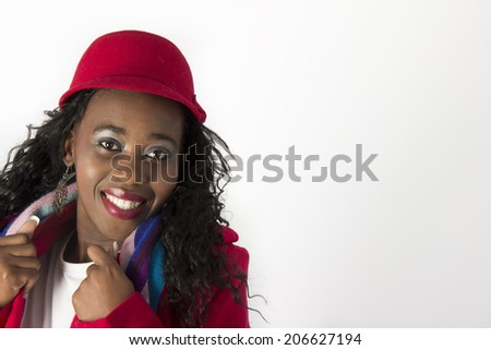 Young Beautiful Black woman holding her scarf and jacket - stock photo