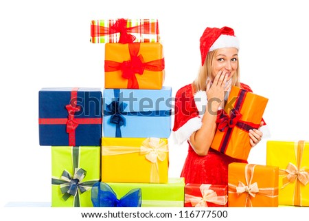 Young beautiful blond cute woman in Santa costume with Christmas gift boxes, isolated on white background. - stock photo