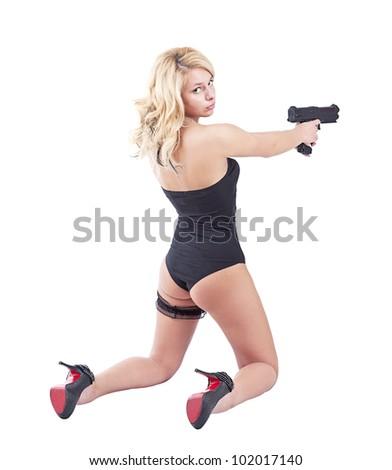 Young beautiful blond girl holding gun - stock photo