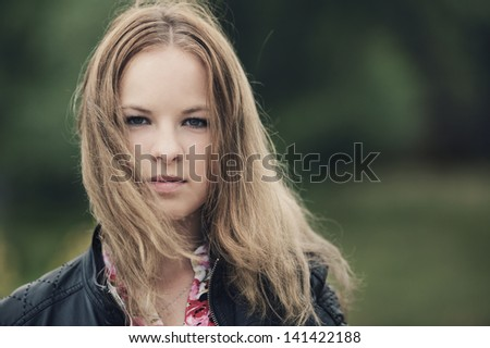 young beautiful blond girl portrait