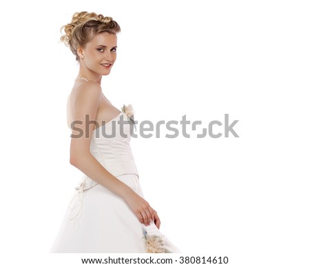 Young beautiful blond girl with a wedding hairstyle. Portrait of the bride on a white background isolated