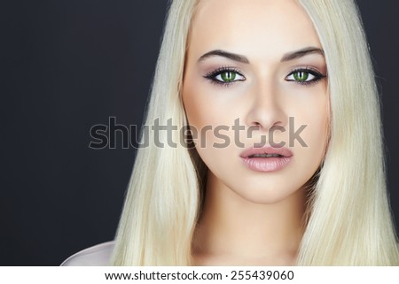 Young Beautiful blond woman.Beauty Girl.close-up make-up portrait.green cat eyes - stock photo