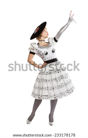 young beautiful blond woman in a designer dress in the studio - stock photo