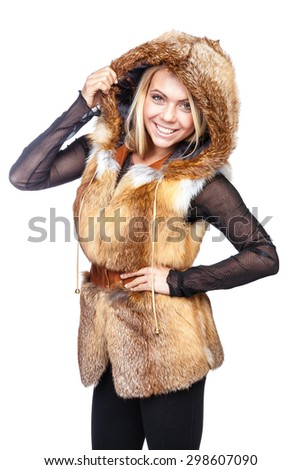 Young beautiful blond woman in a red fur vest - stock photo