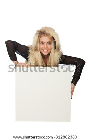 Young beautiful blond woman in a red fur vest
