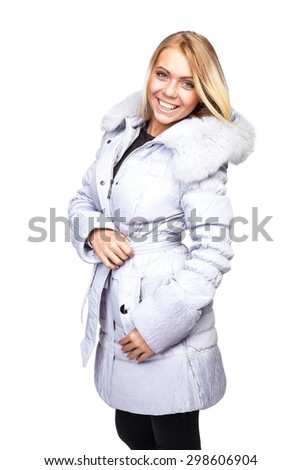 Young beautiful blonde girl in a white coat with fur collar - stock photo
