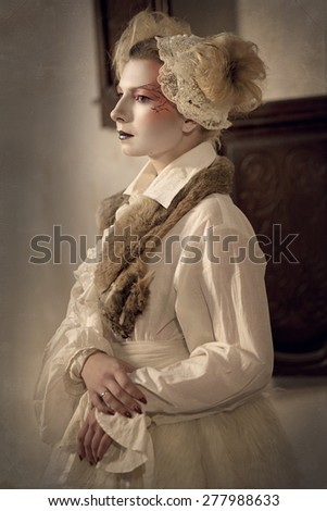 Young beautiful blonde girl in a white vintage dress, a fur cape in the form of a porcelain doll