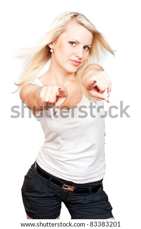 Young beautiful blonde girl pointing to you isolated on white background
