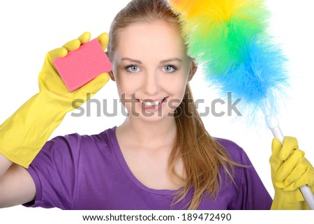 Young beautiful blonde housewife cleaning isolated on white background - stock photo