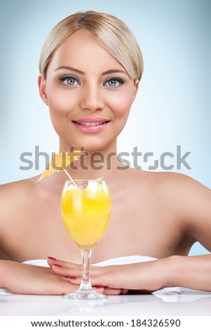 young beautiful blonde woman drinking cocktail in a summertime - stock photo