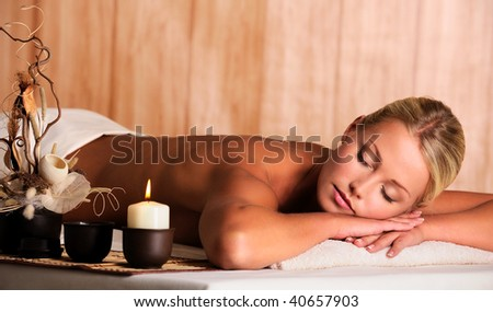 Young beautiful blonde woman get relax in the spa salon - stock photo