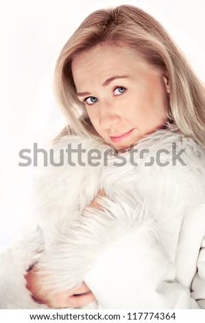 Young beautiful blonde woman, girl portrait  isolated on white background wearing white winter fur coat