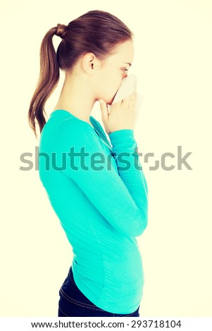 Young beautiful blonde woman sneezing - stock photo