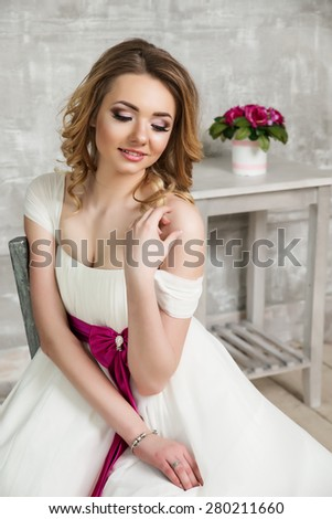 Young beautiful bride. Blonde in a wedding dress wedding dress