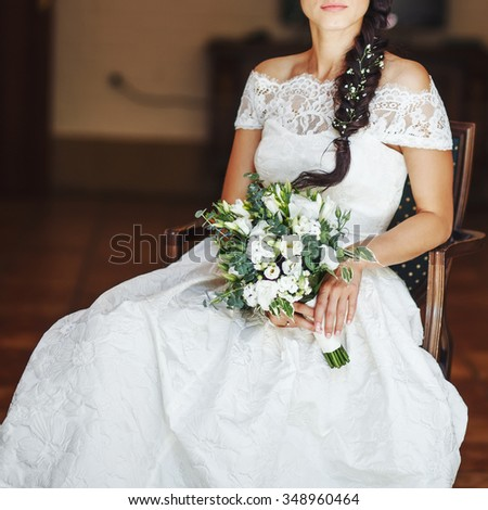 Young beautiful bride enjoying wedding day. Happy newlyweds. Bridal picture.
