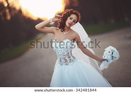 young beautiful bride in a wedding dress with a bouquet
