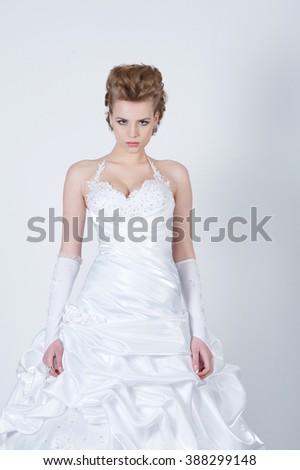 young beautiful bride in wedding dress - stock photo