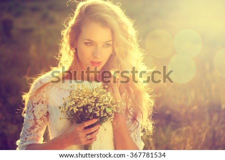 Young Beautiful Bride Outdoors at Sunset