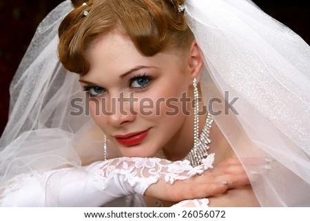 Young beautiful bride with red hair