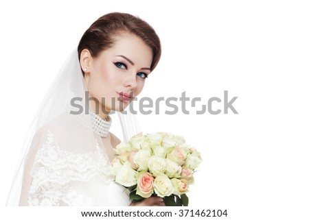 Young beautiful bride with stylish make-up and hairdo holding bouquet over white background, copy space - stock photo