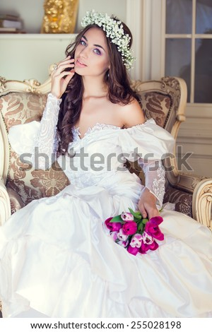 Young beautiful bride with wreath of flowers - stock photo