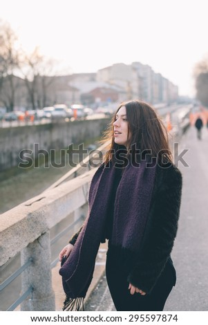 Young beautiful brunette caucasian girl dancing in the street. - freedom, dance concepts - stock photo