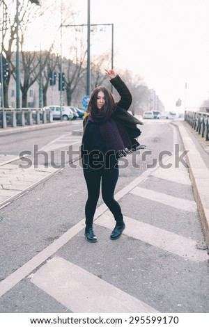 Young beautiful brunette caucasian girl dancing in the street. - freedom. dance concepts