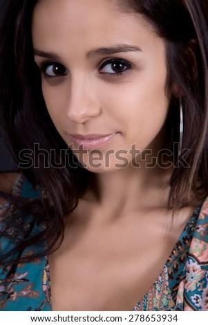young beautiful brunette portrait against black background - stock photo