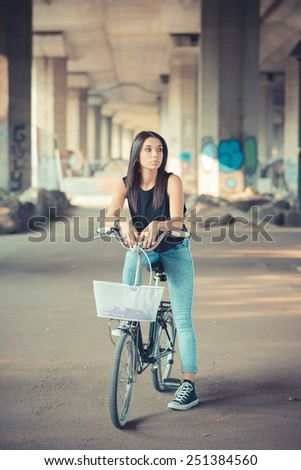 young beautiful brunette straight hair woman using bike outdoor