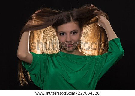 young beautiful brunette with long hair in green tunic