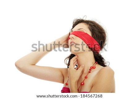 Young beautiful brunette with red eyeband and necklace. Isolated on white. - stock photo