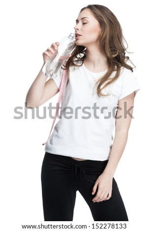 young beautiful brunette woman drinking water from bottle
