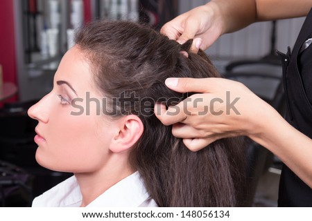 young beautiful brunette woman in hairdressing salon - stock photo