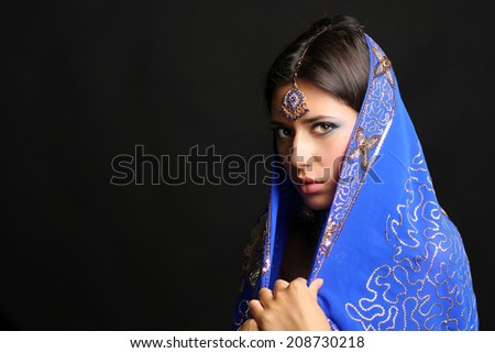 Young beautiful brunette woman in indian blue dress - stock photo