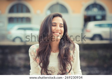 young beautiful brunette woman in the city - stock photo