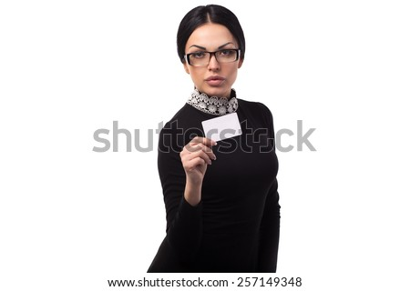 young beautiful brunette woman wearing cool glasses with card in hand - stock photo
