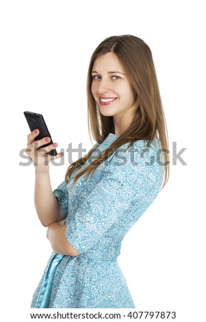 Young beautiful brunette woman writes a message on the phone, isolated on white background