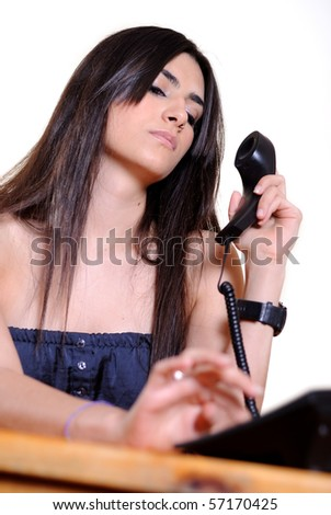 Young beautiful business lady on a chair  calling by phone