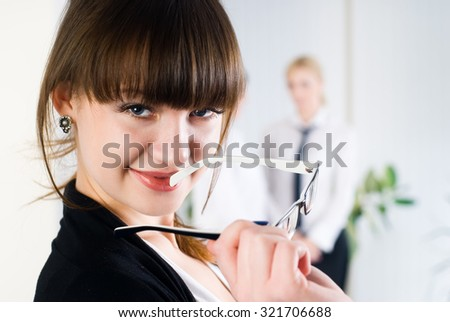 Young beautiful business woman in office over colleagues background - stock photo