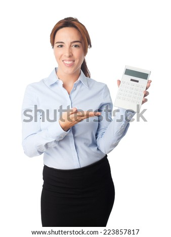 Young beautiful business woman over white background. Pointing with her finger to a white calculator
