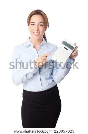 Young beautiful business woman over white background. Smiling and showing a calculator