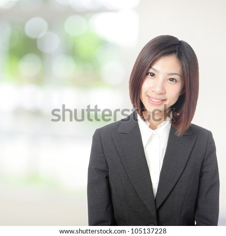 Young beautiful business woman smile portrait with nature green background, model is a asian beauty - stock photo