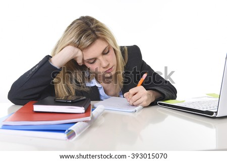 young beautiful business woman suffering stress working at office computer desk feeling tired and desperate looking overworked writing on pad overwhelmed and frustrated - stock photo