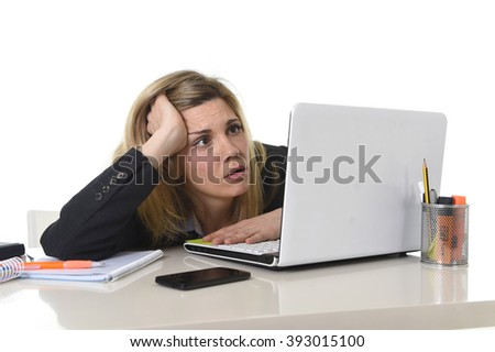 young beautiful business woman suffering stress working at office computer desk feeling tired and desperate looking overworked overwhelmed and frustrated in mess chaos situation - stock photo