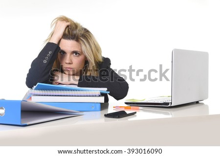 young beautiful business woman suffering stress working at office computer desk load of paperwork feeling tired and desperate looking overworked overwhelmed and frustrated - stock photo