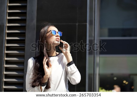 Young beautiful business woman talking on mobile phone - stock photo