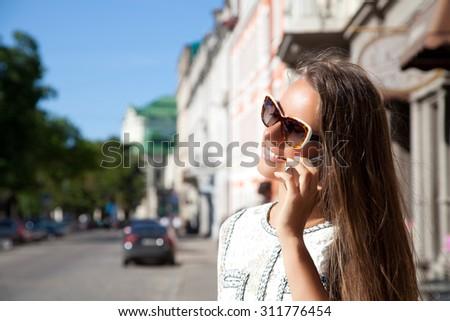 Young beautiful business woman talking on smart phone.  - stock photo