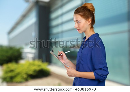 young beautiful business woman with clipboard