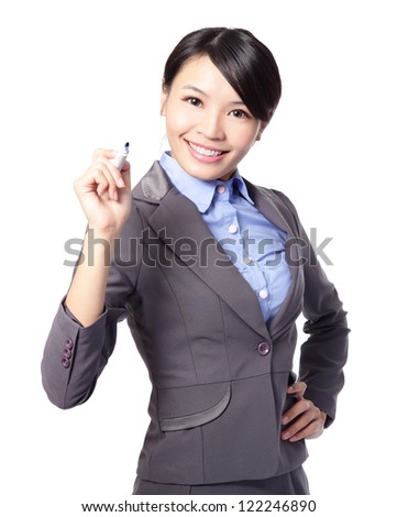 Young beautiful business woman with pen writing something in the air isolated on white background. Focus on blue maker pen. great for you add stock graph, asian woman model - stock photo