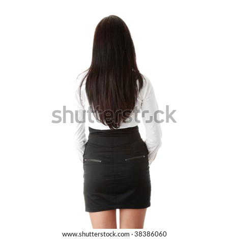 Young beautiful businesswoman from back isolated on white background
